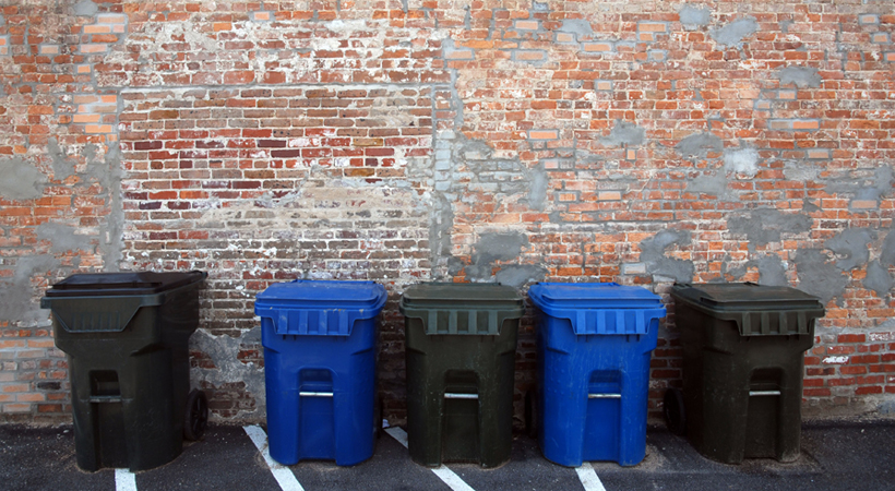 different bins used in a commercial recycling program