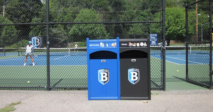 Bentley University campus recycling program bin placement at outdoor tennis court