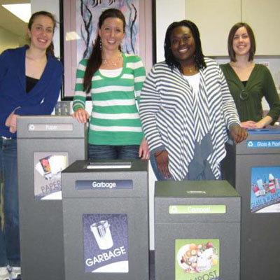 Wilfrid Laurier University campus recycling team posing with CleanRiver waste bins
