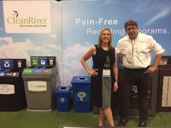 Antonia Edwards and Tom Lembo in front of CleanRiver Recycling Solution's booth at AASHE